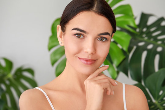 Beautiful young woman with healthy skin at home
