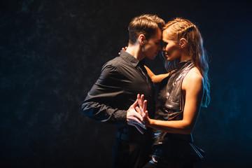 Fototapeta young couple in elegant evening dresses dancing obraz