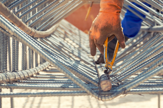 A construction worker fixing steel bar at construction site