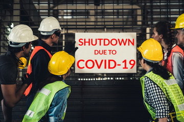 Factory shutdown due to outbreak of Coronavirus Disease 2019 or COVID-19. Concept of economic crisis, people unemployment and production
