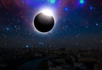 the solar eclipse in the sky over the city, elements of this image is furnished by nasa Fotomurales