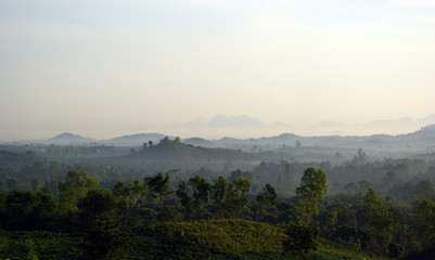 Wall Mural - Morning mist and mountain view in the countryside