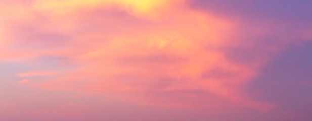 Beautiful coral sky with pink and violet clouds