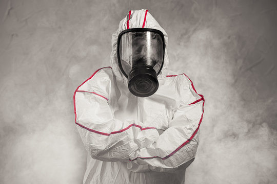 professional disinfector fully armed with necessary equipment, ready to conduct disinfection in all areas, cleaning, removing all bacterias COVID-19, coronavirus.