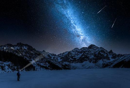 Stunning Morskie Oko mountain lake in winter and milky way