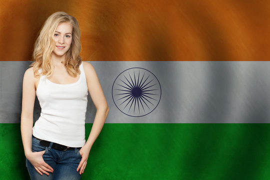 India concept. Happy blonde woman with the India flag background. Travel and learn hindi language