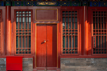 Red wooden window and door, decoration colorful painting beam and wood pole from ancient china palace in forbidden City, Beijing, China