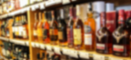 Poster de jardin Bar Alcohol showcase blurred background. Blurred abstract background of shelf in supermarket