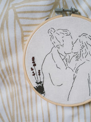 Embroidery frame girl boy kiss