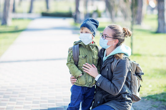 Mother and her son outdoor wearing masks