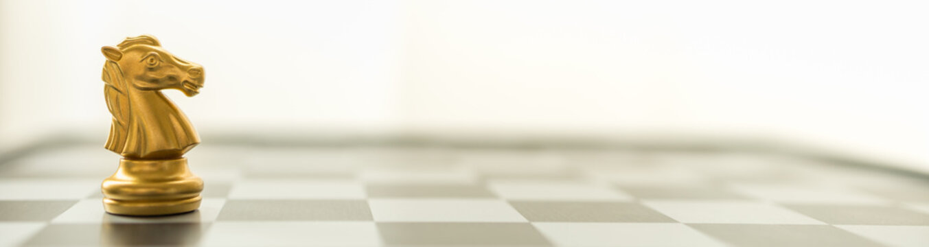 Sport board game, Business and Planning Cover Concept. Closeup of knight chess piece on chessboard with copy space.