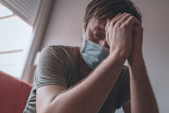 Worried stressed man self-isolated in home quarantine