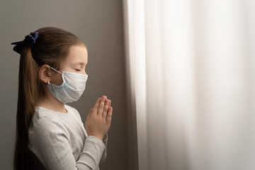 Little girl praying in the morning for a new day freedom to world corona virus.