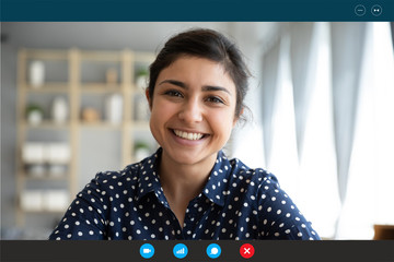 Laptop web cam view head shot of indian woman. E-date online services, video call using phone or...