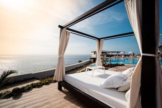Sunbathing bed in a luxury pool hotel with stunning ocean views