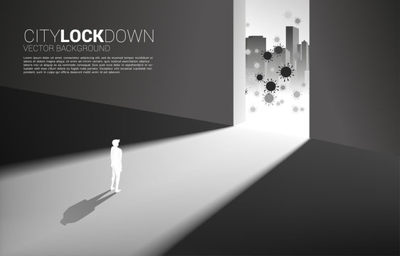 Silhouette of man lock down inside building from virus outside . Concept of city lock down social distancing and isolation.