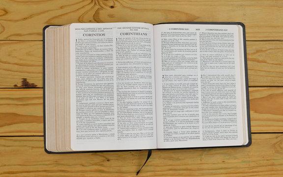 open bilingual bible book on 2 Corinthians, Spanish and english