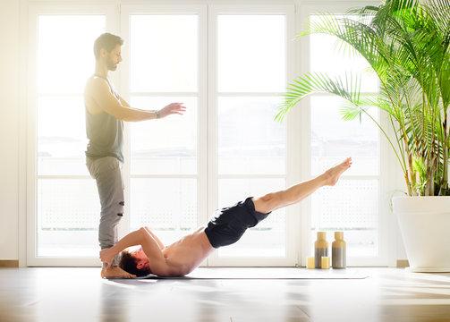 Man doing a dragon flag pose calisthenics exercise
