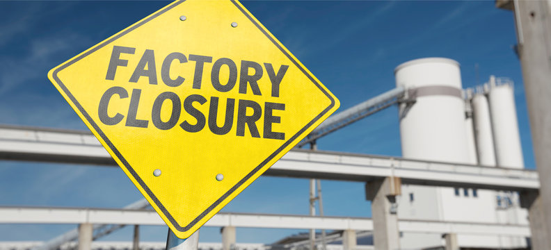 """A sign with the word """"FACTORY CLOSURE"""""""
