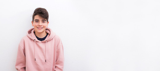 young teenager boy smiling isolated on white background
