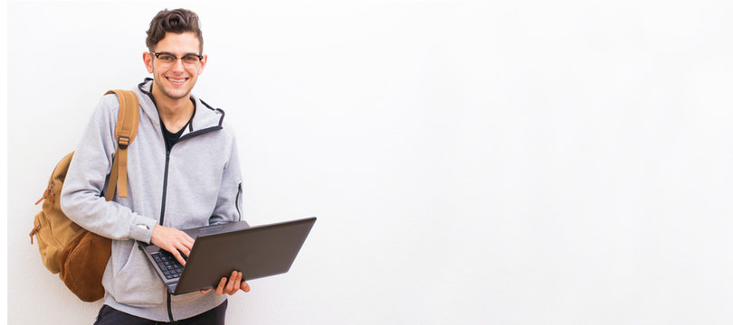 student with computer and backpack on white background