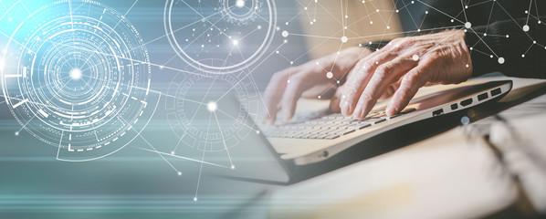 Hands typing on laptop keyboard; panoramic banner