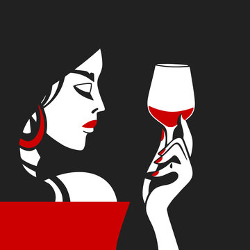 Pretty stylish woman is holding a glass of wine in her hand.