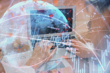Fototapeta Multi exposure of market chart with man working on computer on background. Concept of financial analysis.