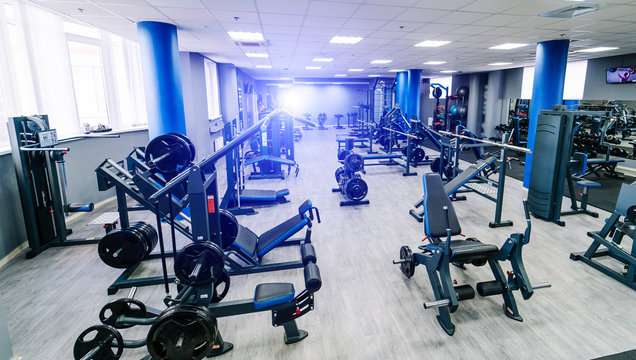 Empty fitness center hall. Modern and empty gym interior with equipment. Different sport equipment in modern gym. Closeup