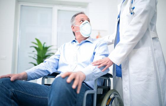 Disabled man wearing a mask during coronavirus pandemic