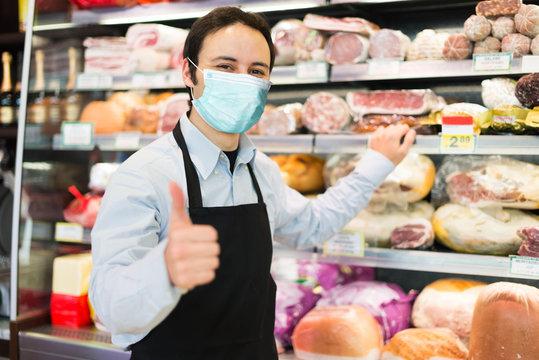 Shopkeeper wearing a mask