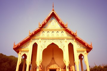Wall Mural - Buddhist temple in Thailand. Retro filtered color style.