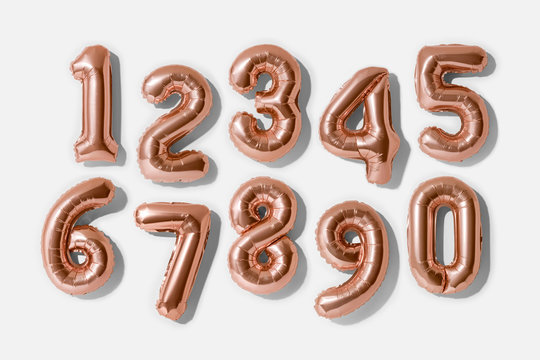 Set of numbers 0-9, Rose gold foil balloon number isolated on a white background