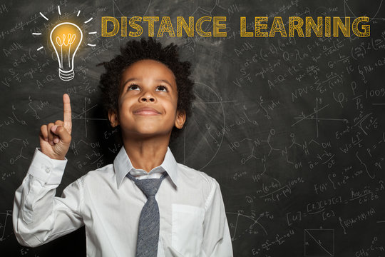 Black child boy with light bulb, science formulas. Distance learning concept