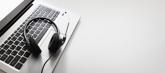 Headset on a laptop computer keyboard