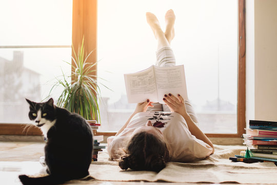 Coronavirus. Quarantine. Online training education and freelance work. Cat and girl studying remotely. Coronavirus pandemic world. social distancing, work from home, stay home concept, home office.