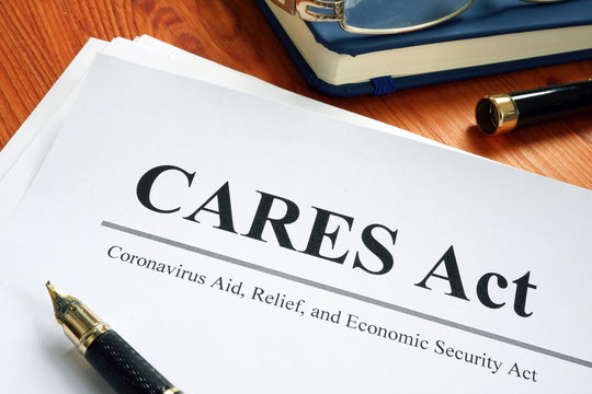 Coronavirus Aid, Relief, and Economic Security CARES Act on the desk.