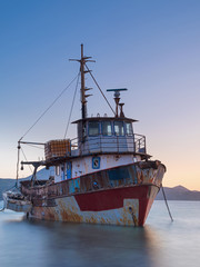 Poster Naufrage ship wreck in port in blue houe after sunrise in Greece