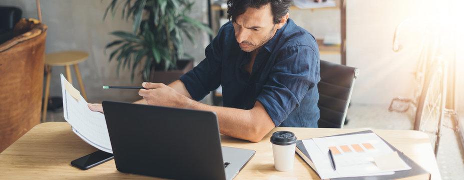 Man working on laptop at bright studio
