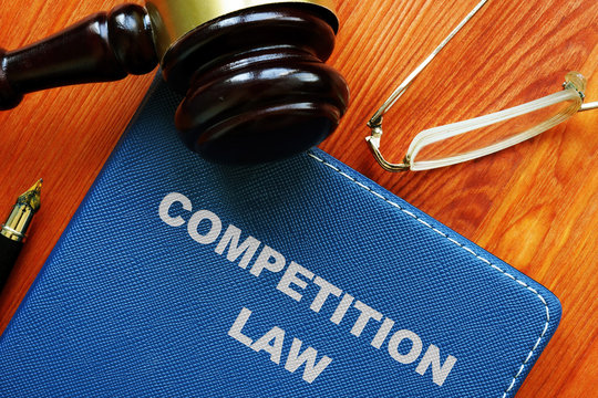 Conceptual photo showing printed text competition law