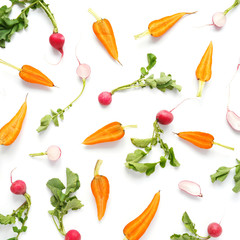 Fototapete - Food pattern of vegetables: carrots, radishes, green tops. Top view, flat lay.