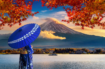 Wall Mural - Asian woman wearing japanese traditional kimono at Fuji mountain. Autumn at Kawaguchiko lake in Japan.