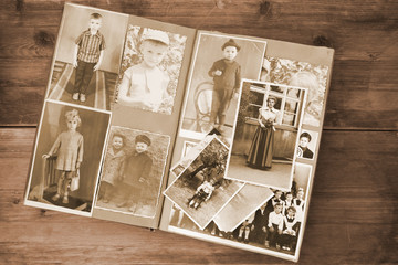Wall Mural - old retro album with vintage monochrome photographs in sepia color, the concept of genealogy, the memory of ancestors, family ties, childhood memories