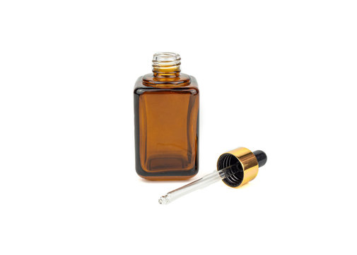 Brown medicine glass bottle with dropper isolated on white background is used for cosmetic skin care product ,containing products and medical supplies.