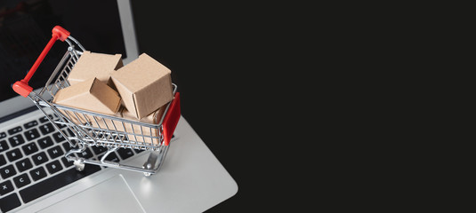 e-commerce, shopping trolley with paper boxes