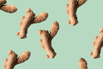 ginger root on green background