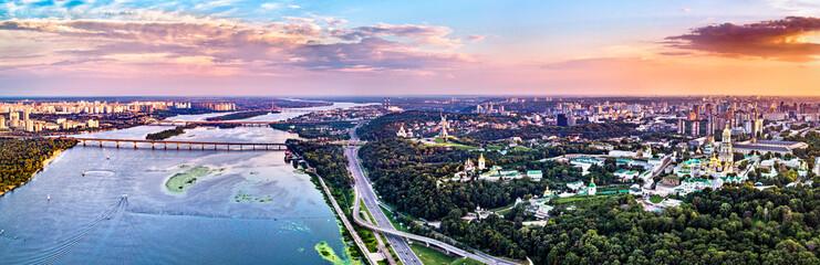 Poster Kiev Sunset above the Dnieper River and Kiev Pechersk Lavra in Kyiv. UNESCO world heritage in Ukraine