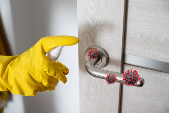 Coronavirus, covid 19 protection. Woman disinfects and cleans door handle with antibacterial wet wipes to protect against viruses, germs and bacteria during coronavirus