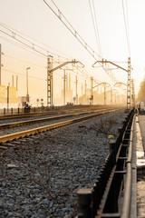 Spain, Barcelona, Badalona, Empty railroad tracks at sunset