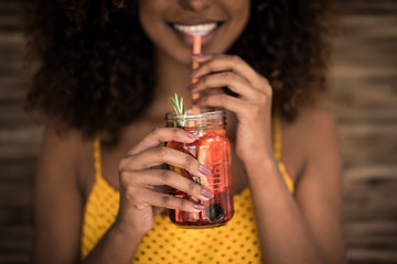 Close-up of woman drinking fresh ice tea drink